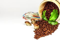 Coffee beans and money. Fair Trade. Sale of coffee. Commodity trade. Fresh coffee beans. Coffee beans and money. Fair Trade. Sale of coffee. Commodity trade royalty free stock photography
