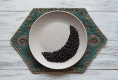 Coffee beans in moon shape on a plate. Ramadan concept stock images