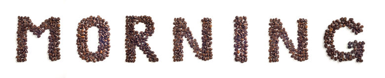 Coffee beans. Morning word made of coffee beans stock image