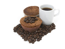 Coffee beans , muffin and coffee cup. Some Coffee beans, muffin and a cup of coffee on white background Stock Photo