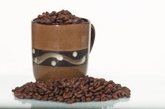 Coffee beans in a mug Royalty Free Stock Image