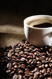 Coffee beans with mug Stock Images