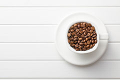 Coffee beans in mug Royalty Free Stock Image