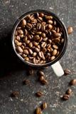 Coffee beans in mug Stock Image