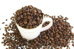 Coffee Beans in Mug Stock Photography