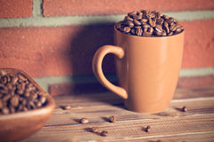 Coffee beans in mug Royalty Free Stock Photography