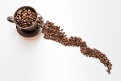 Coffee beans in a mug. Close up of coffee beans and mug stock photo