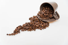 Coffee beans in a mug. Close up of coffee beans and mug royalty free stock images