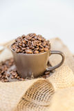 Coffee beans in a mug. Close up of coffee beans in a mug stock image