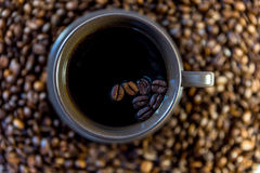 Coffee beans in a mug. Close up of coffee beans in a mug royalty free stock images