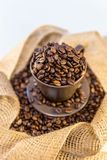 Coffee and beans in a mug. Close up of coffee beans in a mug stock photos