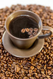 Coffee and beans in a mug. Close up of coffee beans in a mug royalty free stock images