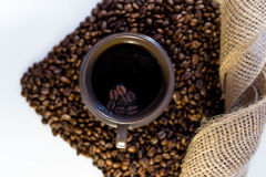 Coffee and beans in a mug. Close up of coffee beans in a mug stock photography