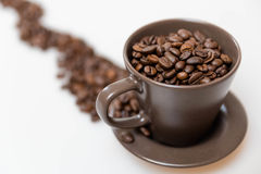 Coffee beans in a mug. Close up of coffee beans in a mug stock photo