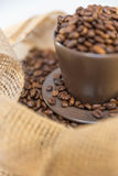 Coffee beans in a mug. Close up of coffee beans and mug stock photos