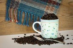 Coffee Beans and Mug Stock Photos