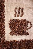 Coffee beans mug on sack cloth background Stock Images