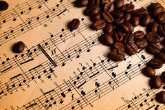 Coffee beans on musical score Royalty Free Stock Photography