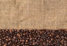 Coffee beans on natural jute background, top view. Roasted coffee beans on natural jute background, top view Stock Photos