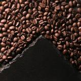 Coffee beans near the stone stock photos