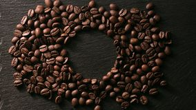 Coffee beans near the stone royalty free stock image