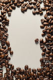 Coffee beans on Neutral Gray Background. Dark Roast Coffee. Dark Roast Coffee on neutral Background Stock Photo