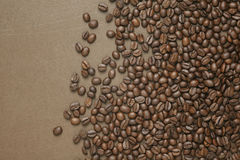 Coffee beans on old brown paper Stock Photos