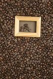Coffee beans on old brown paper Royalty Free Stock Images