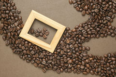 Coffee beans on old brown paper Stock Image