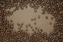 Coffee beans on old brown paper Royalty Free Stock Image