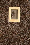 Coffee beans on old brown paper Royalty Free Stock Photo