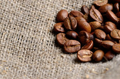 Coffee beans on old burlap canvas Royalty Free Stock Photography