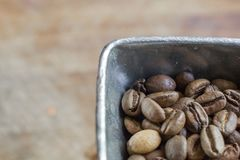 Coffee beans in an old coffee grinder Stock Photos