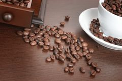 Coffee beans and old coffee mill Royalty Free Stock Image