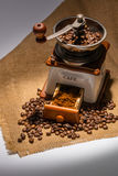 Coffee beans and old coffee mill Stock Photography