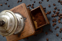 Coffee beans and old grinder Royalty Free Stock Photo