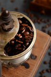 Coffee beans and old grinder Stock Photography