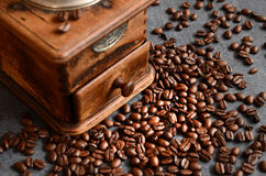 Coffee beans and old grinder Royalty Free Stock Image