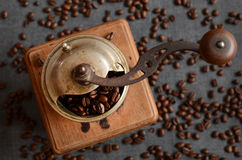 Coffee beans and old grinder Stock Photo