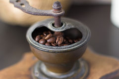 Coffee beans in an old grinder. Coffee beans in an old vintage manual grinder with a handle for preparing coffee the way Grandma used to Royalty Free Stock Image