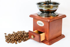 Coffee beans with old grinder Royalty Free Stock Image