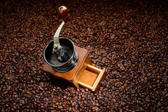 Coffee beans and old hand grinder stock images