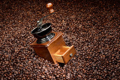Coffee beans and old hand grinder Royalty Free Stock Images