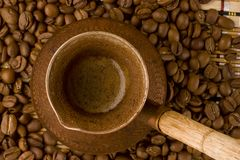 Coffee beans and old jezve. View from above. Stock Photos