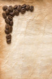 Coffee Beans on Old Paper Stock Photography
