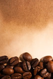Coffee beans on old paper Royalty Free Stock Images