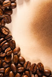 Coffee beans on old paper Stock Photos