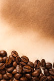 Coffee beans on old paper Royalty Free Stock Photography