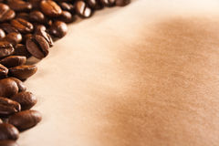 Coffee beans on old paper Stock Images