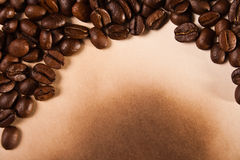 Coffee beans on old paper Royalty Free Stock Photo
